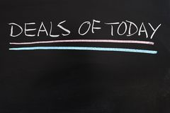 Deals of today. Words written on the chalkboard royalty free stock photo