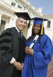 Dean and graduate outside university portrait Royalty Free Stock Photo