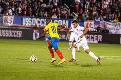 DeAndre Yedlin #2 with Ecuadorian player #10. HARTFORD - OCTOBER 10:  DeAndre Yedlin #2 with Ecuadorian player #10 on US International Friendly match between US Stock Photo