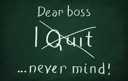 Dear boss, i quit ... never mind!. On the blackboard with chalk write Dear boss, i quit ... never mind Stock Image