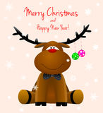 Dear deer Rudolph. Cartoon reindeer on a greeting card with the Christmas Royalty Free Stock Photo