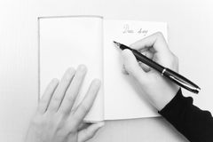 Dear diary. Woman hand writing in a diary Stock Image