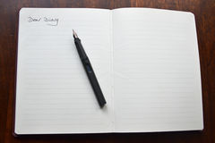 Dear diary. Pages and fountain pen to write a diary entry Royalty Free Stock Images