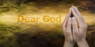 Dear God Website Banner. Male hands in prayer position on a golden streaming background with the words Dear God to the left and plenty of copy space beneath royalty free stock photo
