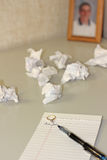 Dear John. Writing a break-up letter. Note pad with the words Dear John handwritten and pieces of crumpled paper with a young man's picture on the background stock photo