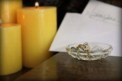 Dear John letter with ring. A Dear John note left by some candles with a ring in the crystal dish Royalty Free Stock Photo