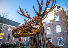 Dear from rusted metal elements. Famous sculptures of Amsterdam city centre. Stock Images