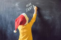 Dear Santa. The boy wrote a message for Santa Claus. Christmas.  Royalty Free Stock Photos