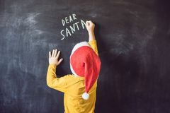 Dear Santa. The boy wrote a message for Santa Claus. Christmas.  Stock Image