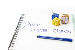Dear santa claus. Letter to Santa Claus of a child with pencil and gifts of ornaments. White background. isolated Stock Photography