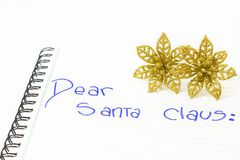 Dear Santa Claus. Letter to Santa Claus with Christmas flowers. White background. isolated Royalty Free Stock Image