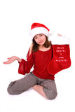Dear Santa, I can explain. Pretty girl wearing red top and Santa hat, holding up a stocking that says 'Dear Santa, I can explain She is holding her other hand royalty free stock photos