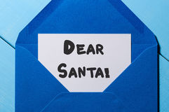Dear Santa - letter to Santa Claus at blue envelope, decorated Christmas background.  Stock Photo