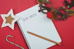 Dear Santa, Letter to santa claus. On red background Royalty Free Stock Photos