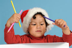 Dear Santa, little boy with christmas hat Royalty Free Stock Photography