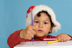 Dear Santa, little boy with christmas hat Royalty Free Stock Photos