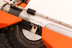 Dear Santa on Typewriter. Dear Santa written with black ink with the old orange Typewriter Royalty Free Stock Photo