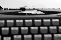 Dear Santa on Typewriter. Dear Santa written with black ink with the old orange Typewriter Stock Photos