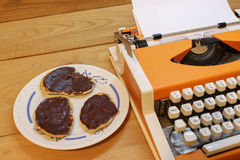Dear Santa on Typewriter. Dear Santa written with black ink with the old orange Typewriter with cakes Royalty Free Stock Photography