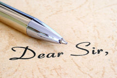 Dear sir. Close up of pen on dear sir text stock photo