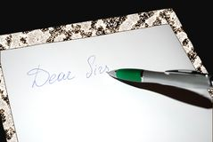 Dear sir note. And pen on the paper Stock Photo