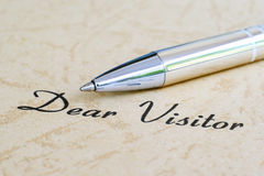 Dear visitor. Close up of pen on dear visitor text stock photography