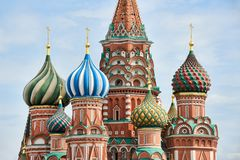 Deatails of Amazing Onion Domes of St. Basil`s Cathedral. MOSCOW, RUSSIA - View from Red Square on the beautiful onion-shaped cupolas domes of St. Basil`s
