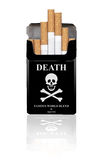 Death. Black cigarette box with skull Royalty Free Stock Image