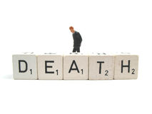 Death. A mourning man behind the word death Royalty Free Stock Photography