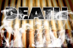 DEATH CANCER. Cigarettes cause cancer and may cause death Royalty Free Stock Image