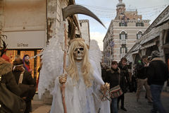 Death carnival costume at the Rialto bridge, Venice Carnival in Stock Photography
