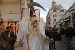 Death carnival costume at the Rialto bridge, Venice Carnival in Stock Photography
