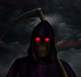 The death is coming. Photomanipulation of the death and his hood in a dark day stock photo