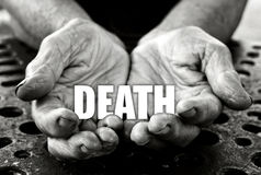 Death concept. In the old female hands Stock Photography