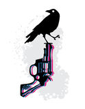 Death on Death. Crow perched on tip of gun Stock Image