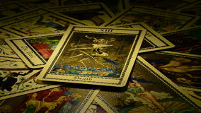 Death and Devil on tarot card. Tarot card of death and the devil gyrating stock footage