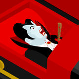 Death of Dracula. Vampire Count in an open coffin. Aspen stake i Royalty Free Stock Photos