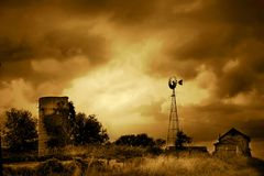 Death of a Farm. A very old farm that has seen it's better days. The sky is very dramatic Royalty Free Stock Photo