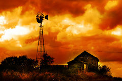 Death of a Farm. A very old farm that has seen it's better days. The sky is very dramatic Stock Photography