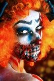 Death games. Portrait of a terrible bloody redhead clown. Halloween. Horror Stock Photos