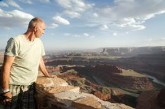 Death Horse Point State Park - USA, Utah. The man looking at the canyon The Colorado River from Death Horse Point State Park, USA, Utah Royalty Free Stock Images