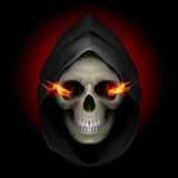 Death image. Skull in black hood with fiery eyes as image of death. Grim Reaper Royalty Free Stock Photos