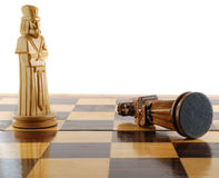 Death of king. Checkmate in a chess party. Figures of a chess are made of a tree - manual work Royalty Free Stock Photography