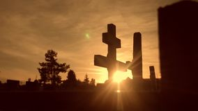 Death life concept. cemetery crosses sunlight glints from behind the graves at sunset cross silhouette lifestyle. Death life concept. cemetery crosses sunlight stock video