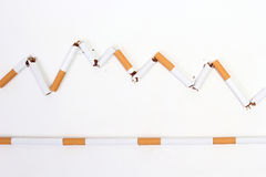 Death or live. Broken cigarette = live. Continuance cigarette = death Royalty Free Stock Photos