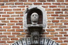 Death mask in a niche in the wall Stock Photography