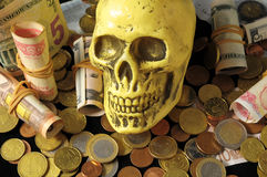 Death and Money Concept Skull Stock Photo
