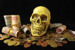 Death and Money Concept Skull with Currency Stock Photos
