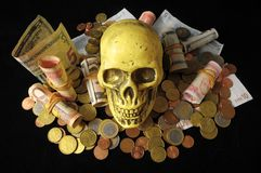 Death money Concept Skull and Currency Royalty Free Stock Images