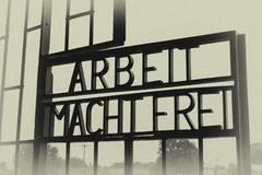 Death motto. Poster with the motto Arbeit Macht Frei at the entrance of the German concentration camps royalty free stock images